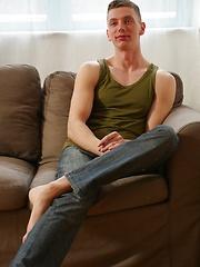 Sexy Euro boy Billy Rock masturbating on the sofa.